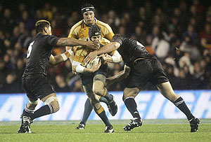 Australia's Stephen Larkham is tackled during the All Blacks v Australia tri nations rugby match at Eden Park, Auckland, New Zealand, Saturday July 21, 2007. New Zealand 26 bt Australia 12. AAP Images