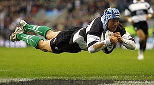 Barbarians' Matt Giteau scores the first try against South Africa - AP Photo/Tom Hevezi