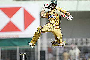 Australia\'s Andrew Symonds reacts after scoring a century. AP Photo/Gautam Singh