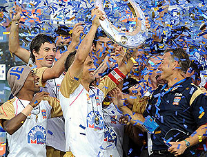 The Newcastle Jets captain Jade North holds up the A-League trophy. AAP Image/Paul Miller