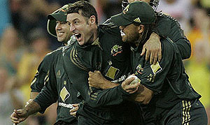 Australia's Mike Hussey celebrates with Andrew Symonds and Ricky Ponting. AP Photo/Rob Griffith