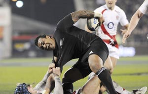 New Zealand All Blacks\' Sione Lauaki is pulled down by England\'s James Haskell during their international rugby test, in Christchurch, New Zealand, Saturday, June 21, 2008. (AP Photo/NZPA, Ross Setford