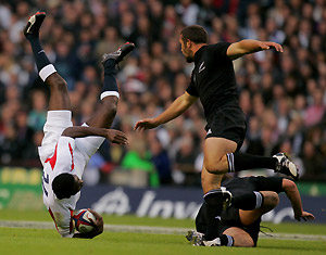 England\'s Paul Sackey, left, hits the ground after making a catch under pressure from unidentified New Zealand players during their rugby union international match at Twickenham stadium in west London, Sunday Nov. 5, 2006. AP Photo/Matt Dunham