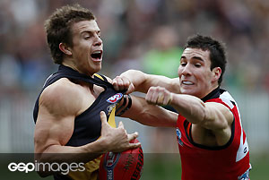 Richmond\' Brett Deledio marks in a contest against Essendon\'s Henry Slattery during the AFL Round 16 match between the Richmond Tigers and the Essendon Bombers at the MCG. GSP Images