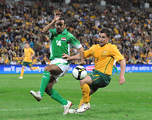 Australia's Scott McDonald and Iraq's Haidar Hussain during the Australian Socceroos v Iraq World Cup qualifier. AAP Image/Dave Hunt