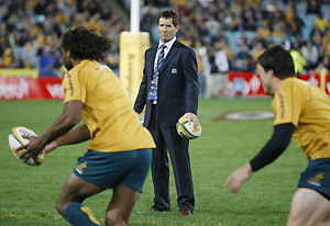 Australian rugby coach Robbie Deans watches his players warm-up before their game against the New Zealand All Blacks in Sydney, Australia, Saturday, July 26, 2008. AP Photo/Mark Baker