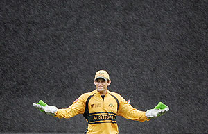 Adam Gilchrist in rain AP Photo/Aman Sharma
