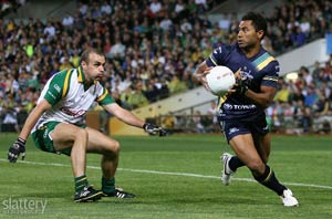David Rodan of Australia evades John Miskella of Ireland during the First Test of the 2008 International Rules Series at Subiaco Oval in Perth. Slattery Images