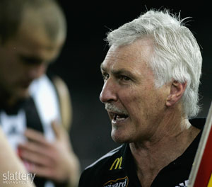Collingwood coach Mick Malthouse addresses his players at quarter time. GSP Images