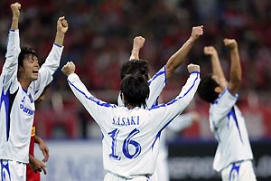 Gamba Osaka's Sota Nakazawa, left, and Hayato Sasaki (16), celebrate with their teammates after their 3-1 victory over Urawa Red Diamonds during their semi-final of AFC Champions League 2008 soccer match in Saitama, near Tokyo, Japan, Wednesday, Oct. 22, 2008. AP Photo/Shizuo Kambayashi