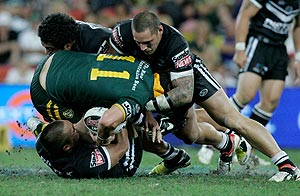 New Zealand's David Fa'alogo, on ground, and Jeremy Smith, top, right, clash with Australia's Anthony Laffranchi (11) during the Rugby League World Cup Final game between Australia and New Zealand in Brisbane, Australia, Saturday, November 22, 2008.