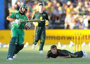 South African batsman HM Amla makes runs as Australian bowler James Hopes follows his misfielded ball during the 4th One Day International cricket match between Australia and South Africa at the Adelaide Oval, Adelaide, Monday, Jan. 26, 2009. AAP Image/Dave Hunt