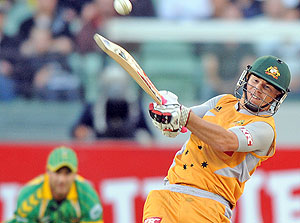 Photo of cricketer David Warner - Australian batsman David Warner strikes the third of his 6's against South Africa during the KFC Twenty/20 match at the MCG in Melbourne, Sunday, Jan. 11, 2009. (AAP Image/Joe Castro)