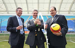Gold Coast United FC head coach and director of football, Miron Bleiberg (centre) celebrates with Football Federation Australia (FFA) CEO Ben Buckley (right) and Gold Coast United CEO Clive Mensink (left) at Skilled Park on the Gold Coast, Thursday, Aug. 28, 2008. The Gold Coast's bid to enter the national A-League competition in 2009/10 was today given the long-awaited approval by the FFA. AAP Image/Dave Hunt