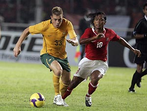Australian Danny Allsopp, left, fight for the ball with Indonesian Hariono, right, during AFC Asian Cup 2011 qualifiers Group B at Gelora Bung Karno in Jakarta, Indonesia, Wednesday, Jan 28, 2009. AP Photo/Achmad Ibrahim