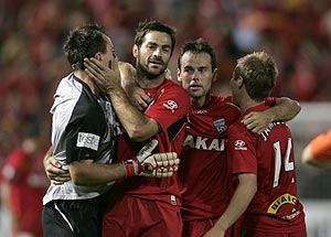 Adelaide United's Sasa Ognenovski celebrates