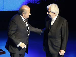 FIFA President Sepp Blatter, left, talks with Football Australia chairman Frank Lowy as they arrive at the opening ceremony for the 58th FIFA congress in Sydney, Thursday, May 29, 2008. AP Photo/Mark Baker