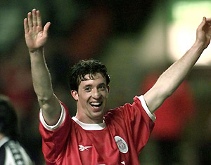 Liverpool's Robbie Fowler celebrates scoring the third goal against 1. FC Kosice during the UEFA Cup, first round, second match at Liverpool's Anfield stadium Tuesday Sept. 29, 1998. AP Photo/Adam Butle