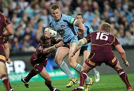 Luke Lewis is tackled by Corey Parker