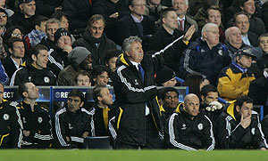 Chelsea's Guus Hiddink, centre gestures as he watches his team play Juventus during their Champions League round of 16 first leg soccer match at Chelsea's Stamford Bridge stadium in London, Wednesday, Feb. 25, 2009. Chelsea won the match 1-0. AP Photo/Carlo Baroncini