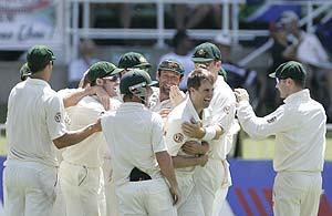 Australia's bowler Simon Katich, third from right, with teammates, celebrates. AP Photo/Themba Hadebe
