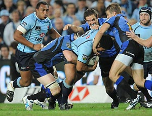 The Waratahs' Tatafu Polota-Nau is tackled determined Western Force defence during the Super 14 match between the Waratahs and the Western Force at the Sydney Football Stadium, Saturday, April 18, 2009. Western Force beat the Waratahs 15-14. AAP Image/Dean Lewins