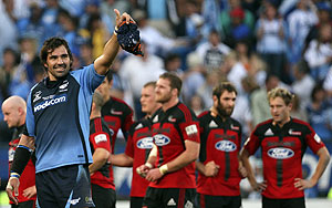 South Africa's Bulls captain Victor Matfield gestures to the fans after winning the semi-final of the Super 14