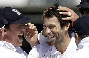 England bowler Graham Onions, right, celebrates with Graeme Swann, left, after taking his second wicket of the day, bowling out West Indies' Devon Smith during the third day of the first Test match between England and West Indies at Lord's cricket ground in London, Friday, May 8, 2009. AP Photo/Matt Dunham