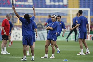 Manchester United's Anderson, left, gestures as teammate Carlos Tevez looks on, during a training session ahead of Wednesday's Champions League final match between Manchester United and Barcelona, at the Rome Olympic stadium, Tuesday, May 26, 2009. AP Photo/Jon Super