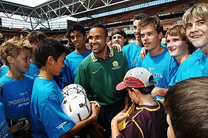 Socceroo Archie Thompson (centre) meets with kids at a soccer clinic at Suncorp Stadium in Brisbane, Wednesday, October 4, 2006. AAP Image/Dave Hunt