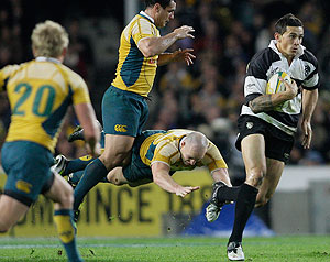 Barbarians' Sonny Bill Williams of New Zealand, right, alludes being tackled by Wallabies' captain Stirling Mortlock, 2nd right, and Benn Robinson during their rugby match in Sydney, Australia, Saturday, June 6, 2009. The Wallabies won the match 55-7. (AP Photo/Rob Griffith)