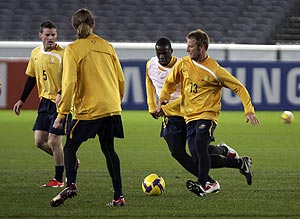 Australian player Vince Grella (right) during the Socceroos pre-match training session at the Melbourne Cricket Ground. AAP Image/Luis Enrique Ascui