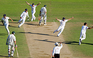 England's Graeme Swann takes the final wicket of Australia's Brad Haddin. AAP Images