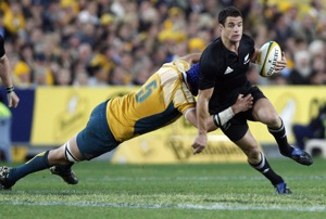 New Zealand's Dan Carter, right, is tackled by Australia's Nathan Sharpe during the Bledisloe Cup rugby match in Sydney, Australia, Saturday, Aug. 22, 2009. New Zealand won the match 19-18 and retain the Bledisloe Cup.(AP Photo/Rob Griffith)