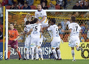 Gold Coast players react after Jason Culina scored in the 59th minute to put the Coast 2-0 up during the 1st round A-League football match between Brisbane Roar and Gold Coast United at Suncorp Stadium in Brisbane, Saturday, Aug. 8, 2009. AAP Image/Dave Hunt