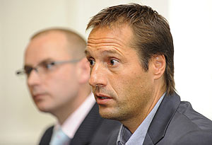 The new coach of A-league team John van't Schip (right) takes questions from the media in Melbourne, Monday, Oct. 12, 2009. Dutchman van't Schip has been appointed coach of Melbourne Heart team whose syndicate hopes to gain entry to the Soccer A-League. AAP Image/Julian Smith