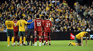 Australian and Oman players clash after Josh Kennedy is knocked down during a FIFA Asian Cup qualifying match, played at Docklands Stadium in Melbourne, Wednesday, Oct. 14, 2009. Australia beat Oman 1-0. AAP Image/Joe Castro