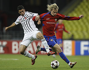 Besiktas Ismail Koybas, left, fights for the ball with CSKA Moscow Milos Krasic during their Champions League soccer match in Moscow, Russia, Wednesday, Sept. 30, 2009. AP Photo/Sergey Ponomarev