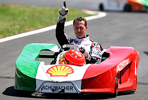 Michael Schumacher, from Germany celebrating at the end of the karting event charity race International Challenge of the Stars. AP Photo/ Nabor Goulart