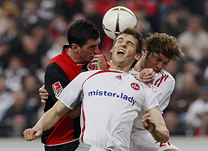 Martin Fenin from Frankfurt, left, and from Nuremberg Matthew Spiranovic, center, and Jacques Abardonado, right, challenge for the ball. AP Photo/Daniel Roland