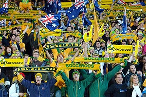 Australian soccer fans enjoy the atmosphere at the Melbourne Cricket Ground. AAP Image/Julian Smith