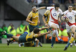 England's Danny Cipriani, right, runs with the ball. AP Photo/Matt Dunham