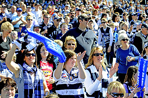 Geelong supporters cheer for their team at Kardinia Park. AAP Image/Julian Smith