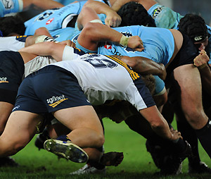 The Brumbies and the Waratahs pack down. AAP Image/Dean Lewins