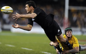 New Zealand All Blacks' player Dan Carter, left gets the ball away from Australia's Berrick Barnes during their Bledisloe Cup rugby test.