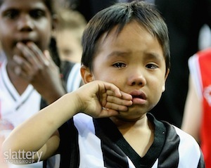 Child in tears following the 2010 AFL grand final draw