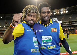 Sri Lanka's Lasith Malinga, left and Angelo Mathews