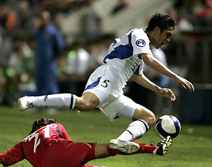 Adelaide United's Jason Spagnuolo is pushed from the ball by Byungkuk Cho of Seongnam Ilhwa. AAP Image/ Rob Hutchison