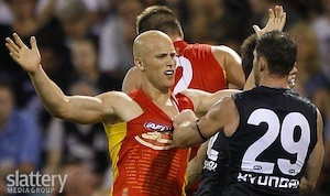 Gary Ablett of the Gold Coast Suns and Heath Scotland of the Blues wrestle during the AFL Round 02