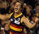 Taylor Walker of the Crows celebrates a goal during the AFL Round 01 match between the Adelaide Crows and the Hawthorn Hawks at AAMI Stadium, Adelaide. Slattery Images